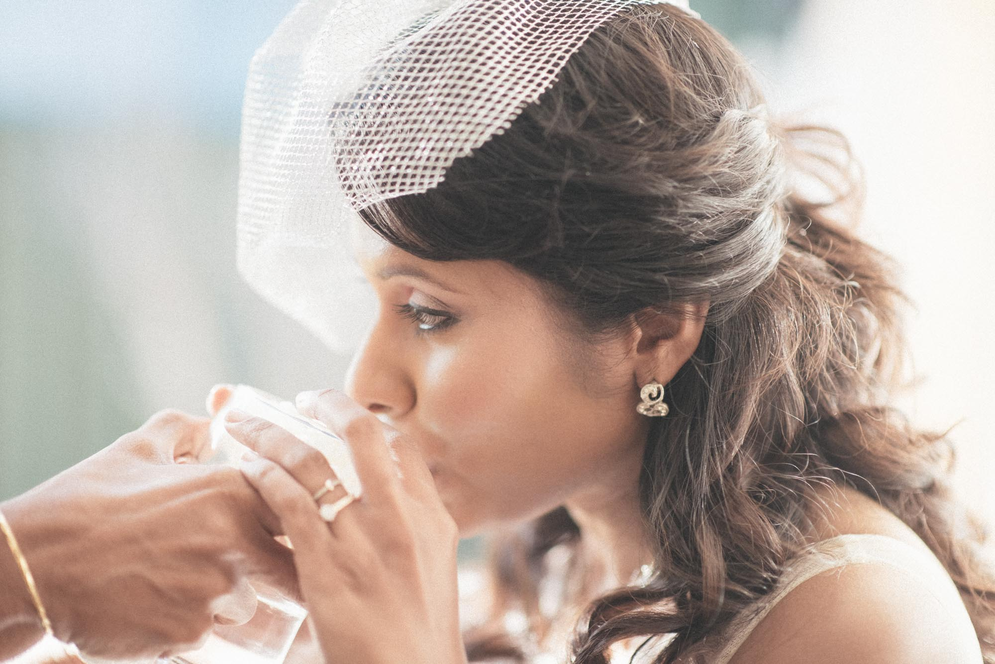 Gorgeous Sri Lankan bride drinks her blessing before her wedding in Melbourne.