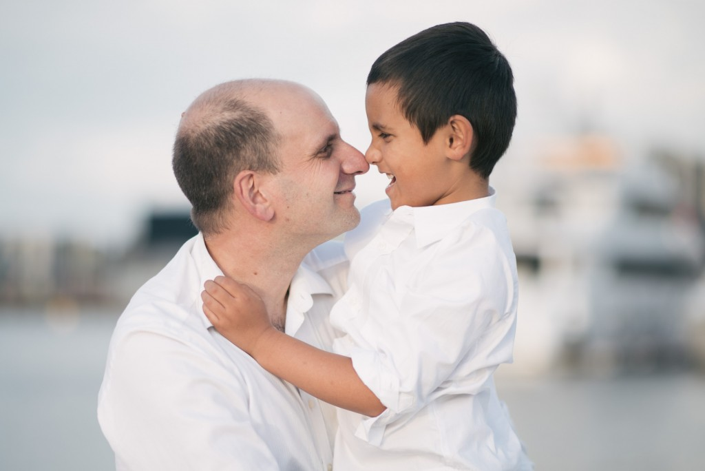 Father and son share a smile at the Docklands family photography.