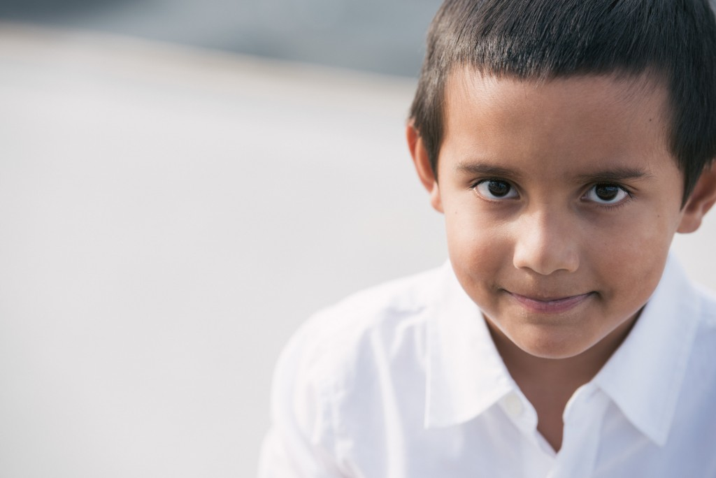 Boy smiles at Docklands family portrait session.