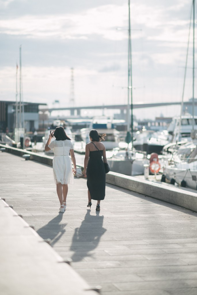 Mother and daughter walk along the Docklands