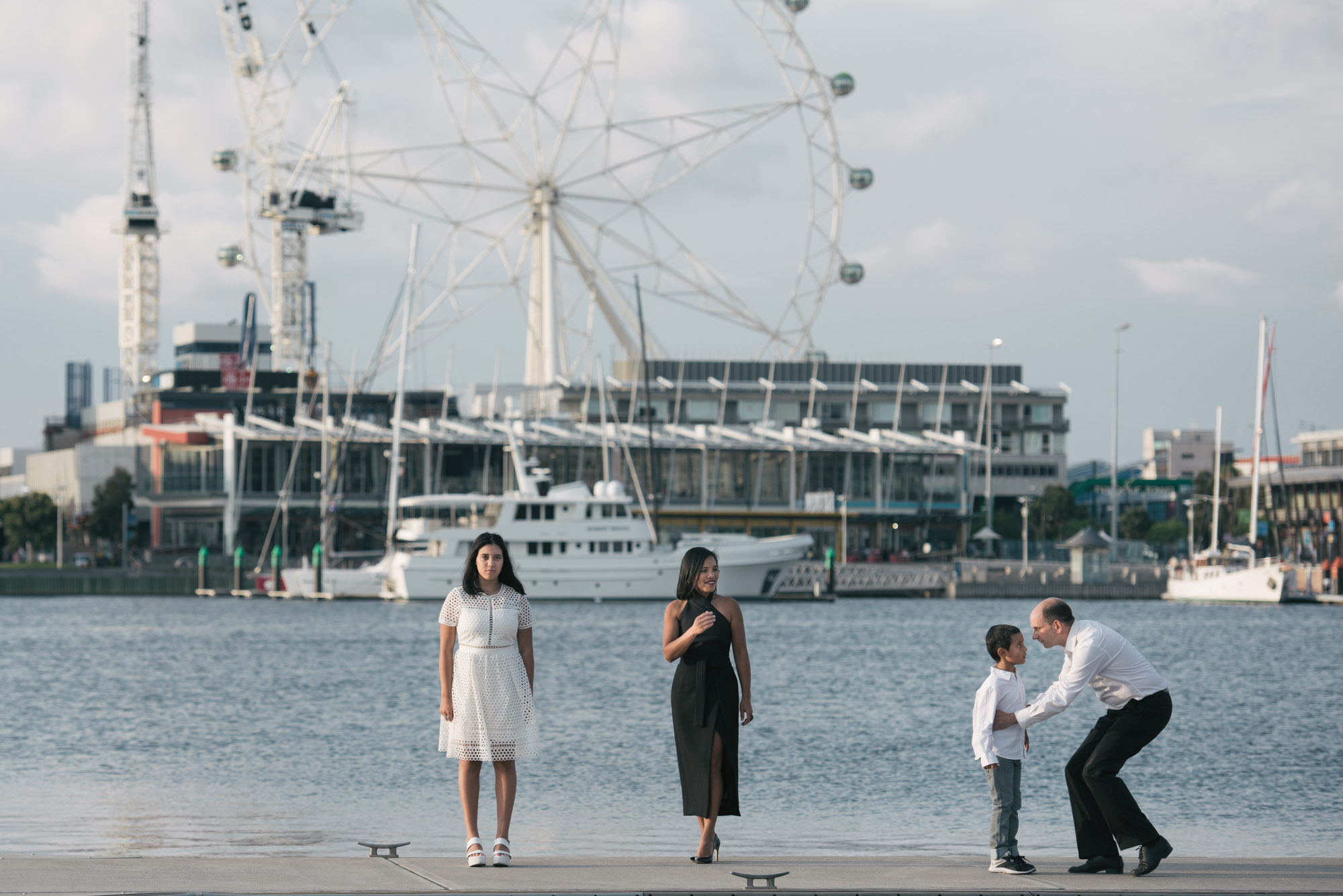 Family stand on a wharf for their Melbourne family photography session.