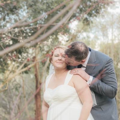 Couple pose in bushland for photography