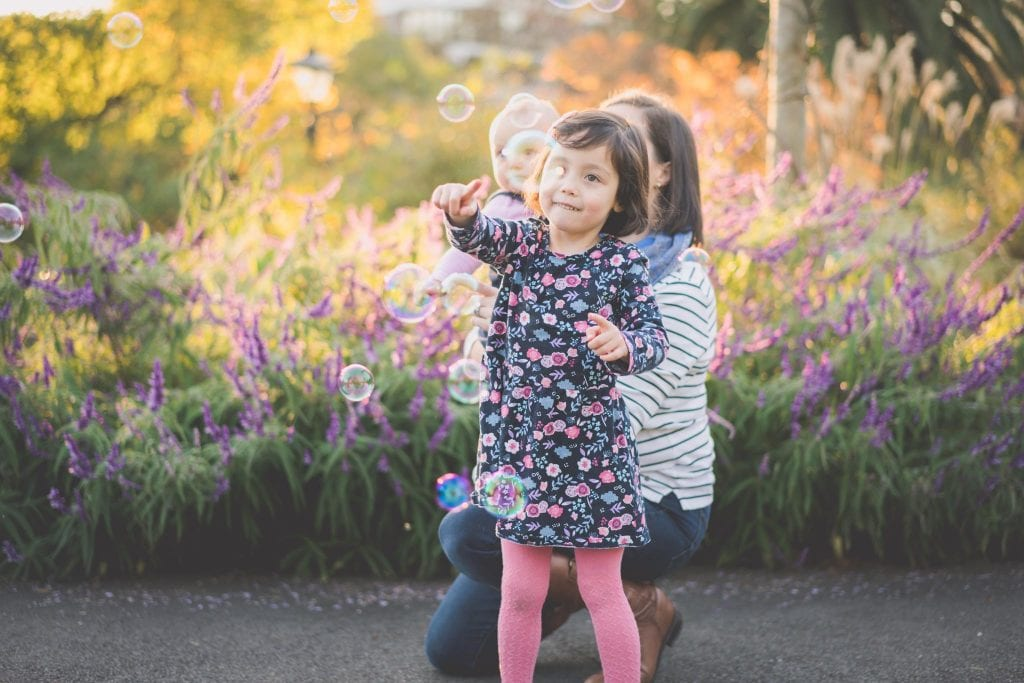 Mother and Daughter play with bubbles. Melbourne family photography packages from $650