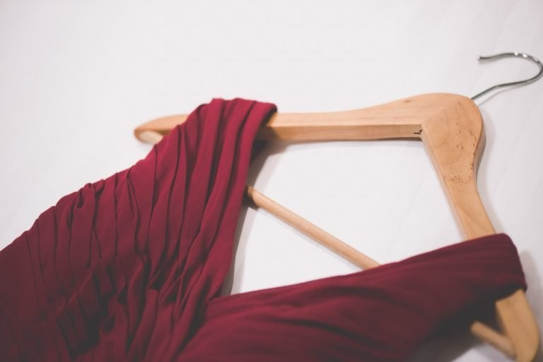 A red bridesmaids dress on a wooden coathanger