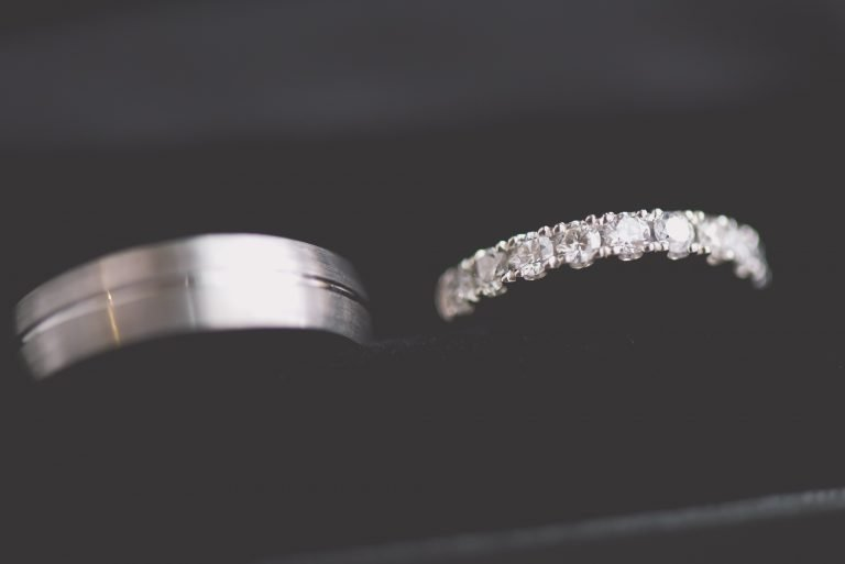 The brides and grooms wedding ring sparkle in their black box