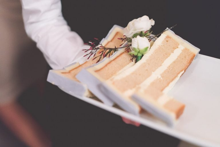 Beautiful slices of wedding cake with white flowers on a tray at alto GPO in Melbourne