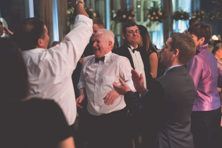 Men in suits and bowties dancing on the dancefloor at a Melbourne GPO wedding