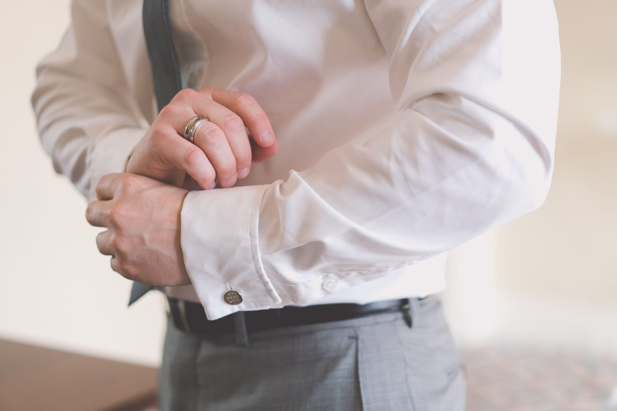 A groom and just his cufflinks at the hotel Windsor. Melbourne wedding photography bye for the Moment