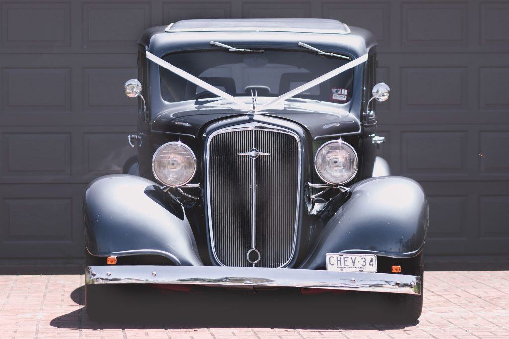 A 1934 Chevrolet sits in the driveway