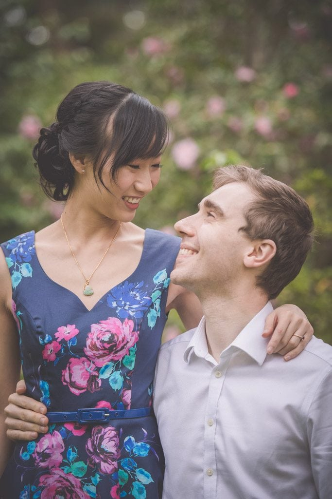 Gorgeous couple laugh during the engagement photography session