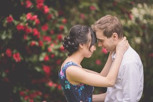 Spring Engagement photography in Melbourne. Couple hug in front of beautiful flowers