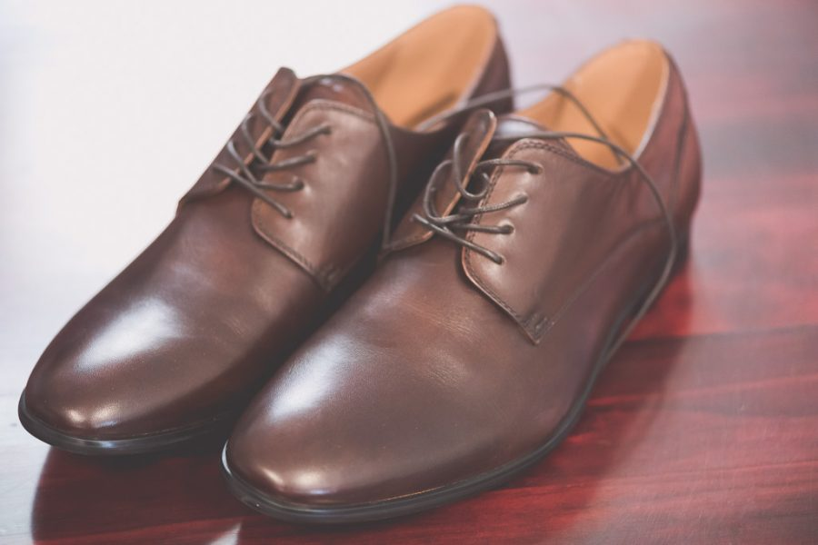 Shoes polished ready for a Melbourne wedding. Photography by Pause The Moment