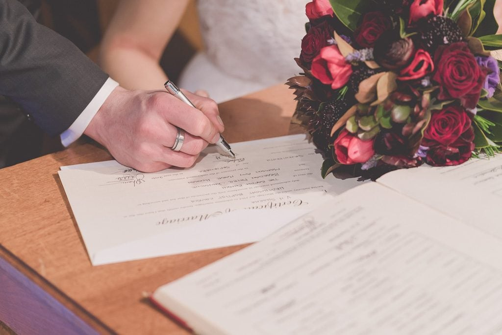 Signing the marriage certificate at a Melbourne wedding.
