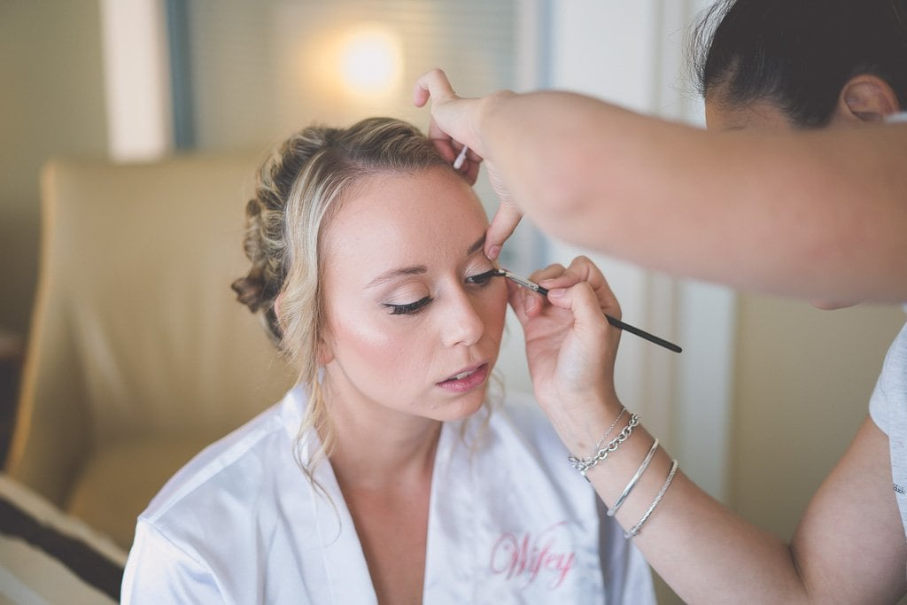 Last minute makeup touch up for a bride