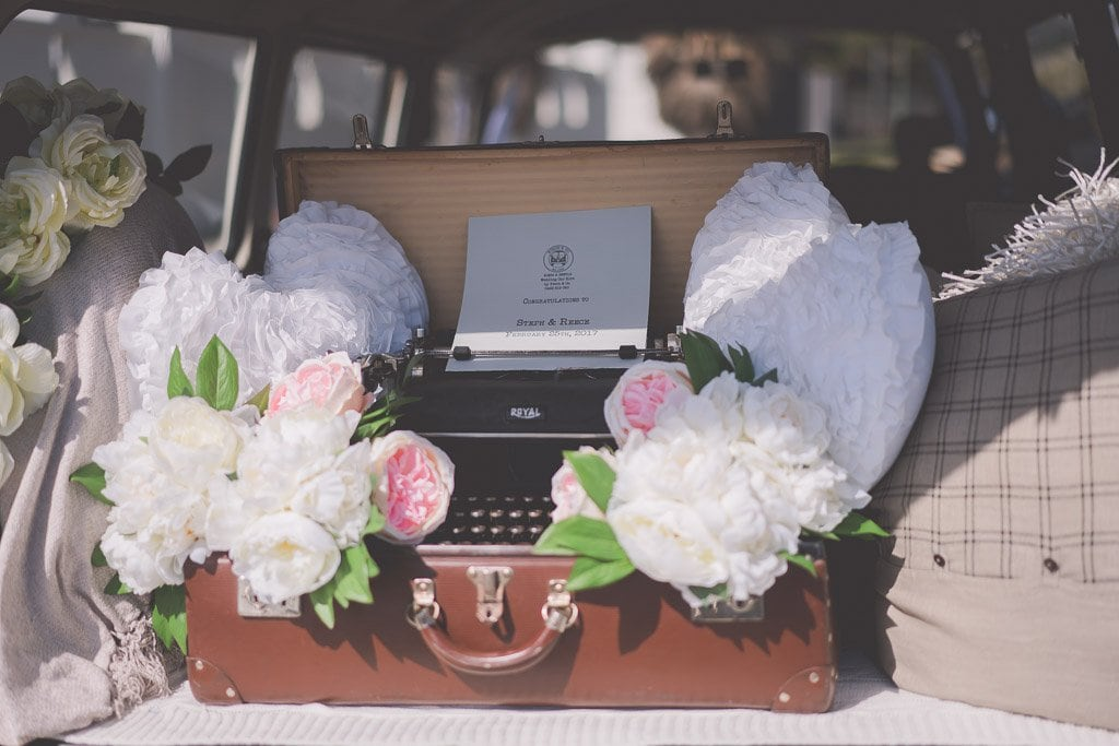 A typewriter in the back of a kombi hired for a wedding.