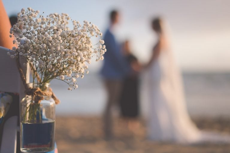 Flowers on a beach at a wedding
