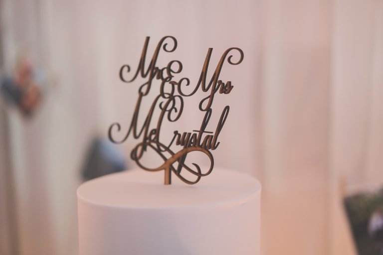 Bride and groom's name laser cut into the top of the cake ornament