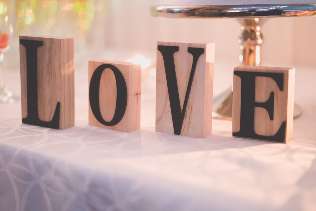 Block letter spell out the word Love