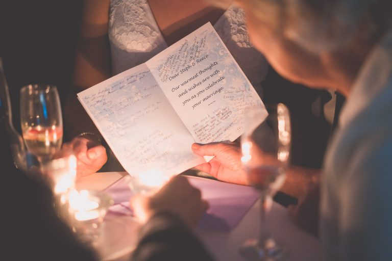 Guests read a card for the bride and groom.
