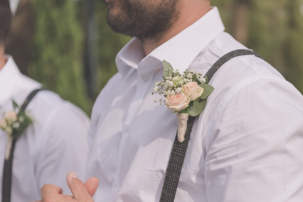 A closeup of groomsman boutonniere at Stillwater Crittenden Estate at their Mornington Peninsula wedding photography.