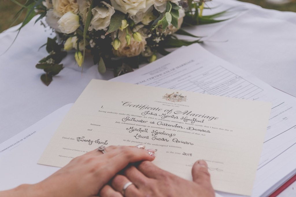 The couple's hands on their wedding certificate during their Mornington Peninsula wedding photography.