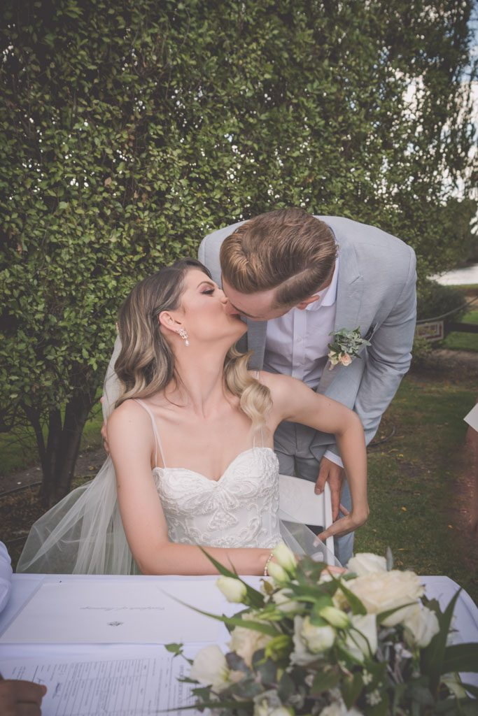 Bride and groom kiss after signing their papers. Mornington Peninsula wedding photography by Pause The Moment