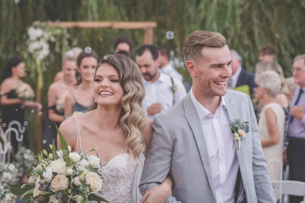 Laura and Mitch walk down the aisle at Stillwater. Mornington Peninsula wedding photography by Pause The Moment