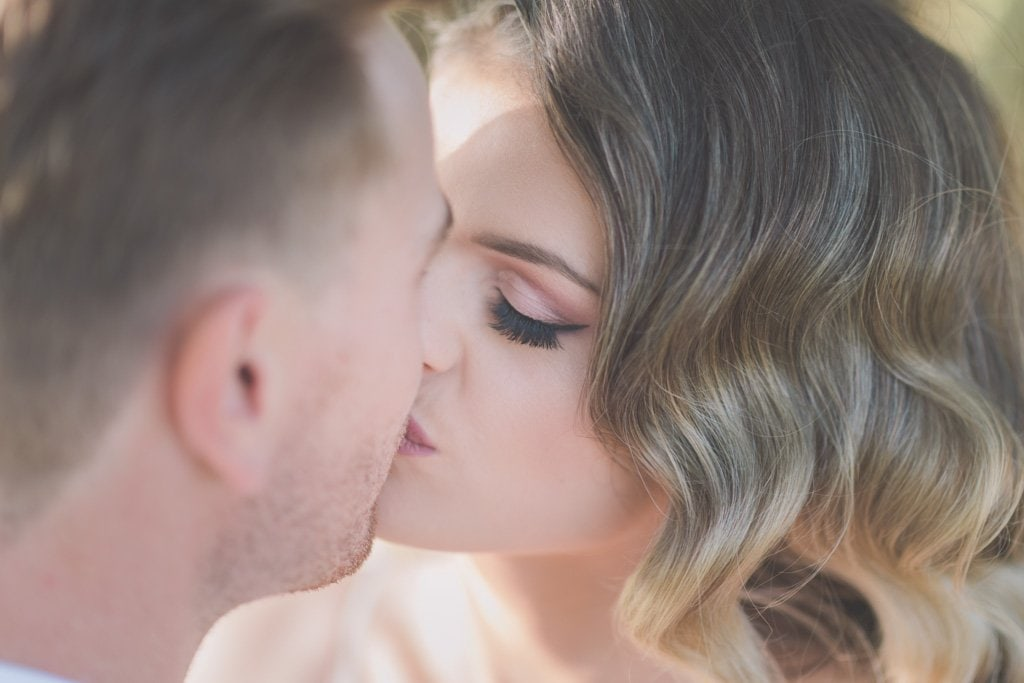 Brride and groom kiss at their Mornington peninsula wedding.