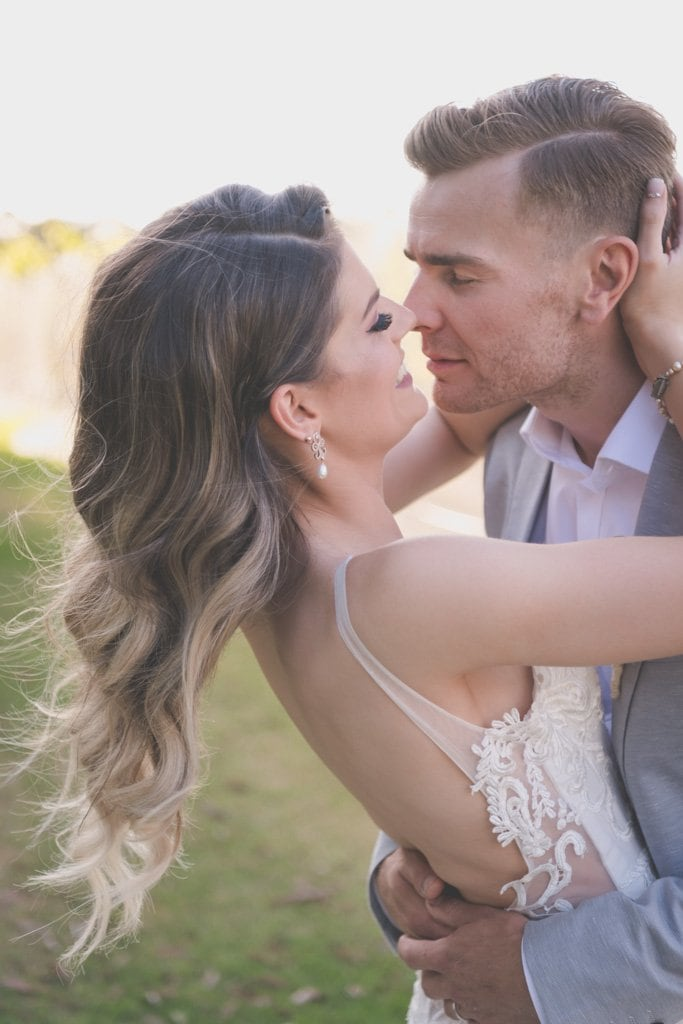 The Groom leans in for a kiss. Mornington Peninsula wedding photography by Pause The Moment