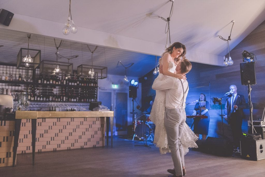 The groom lifts the bride into the air during their wedding dance towards the end of their Mornington Peninsula wedding photography.