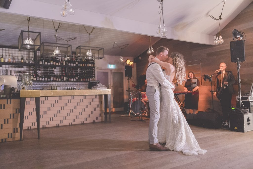 The couple kiss during their wedding dance towards the end of their Mornington Peninsula wedding photography.
