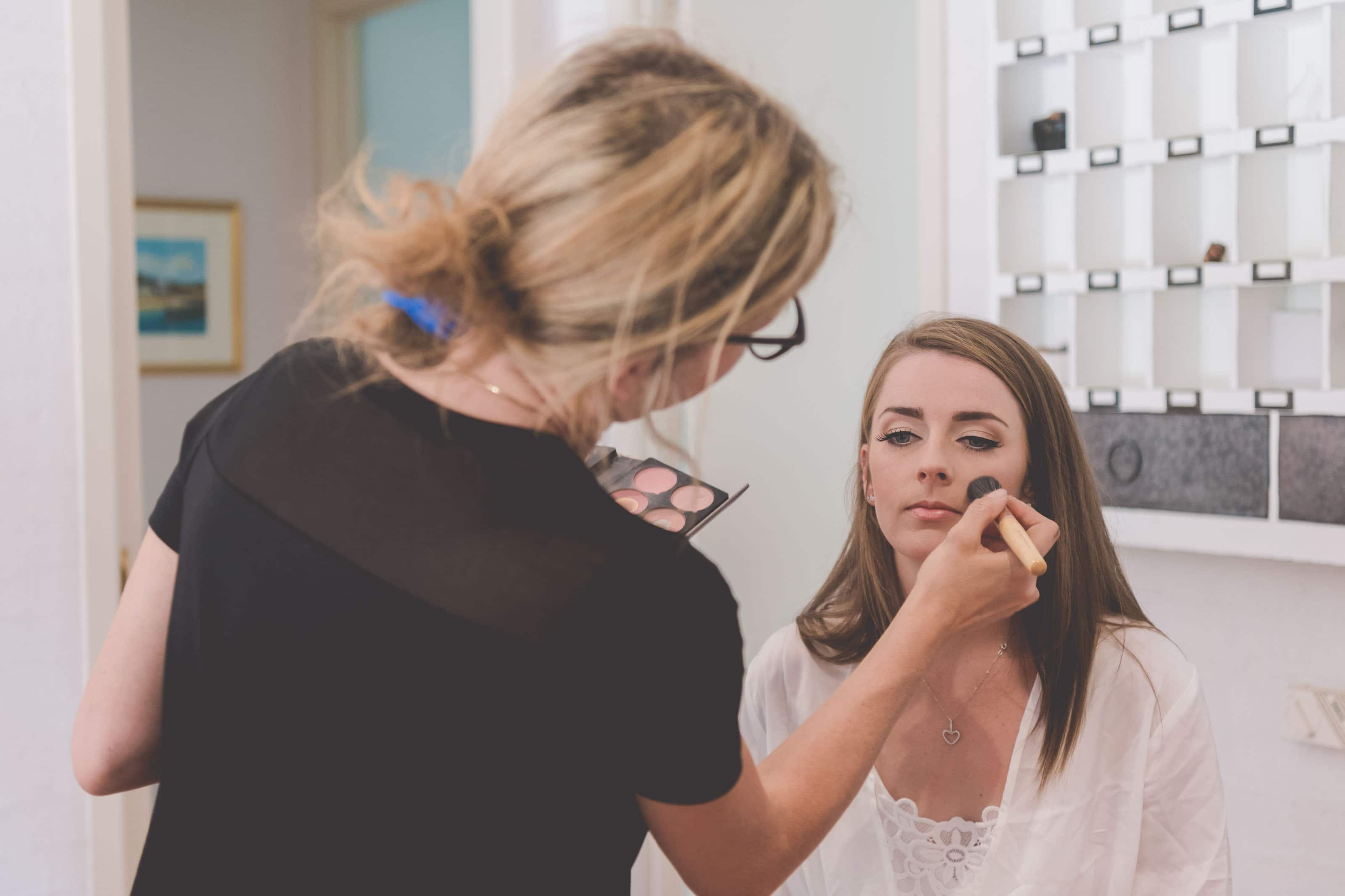 Wedding Photography Melbourne by Pause The Moment - Bride has her makeup applied - Paringa Estate Wedding Photographer