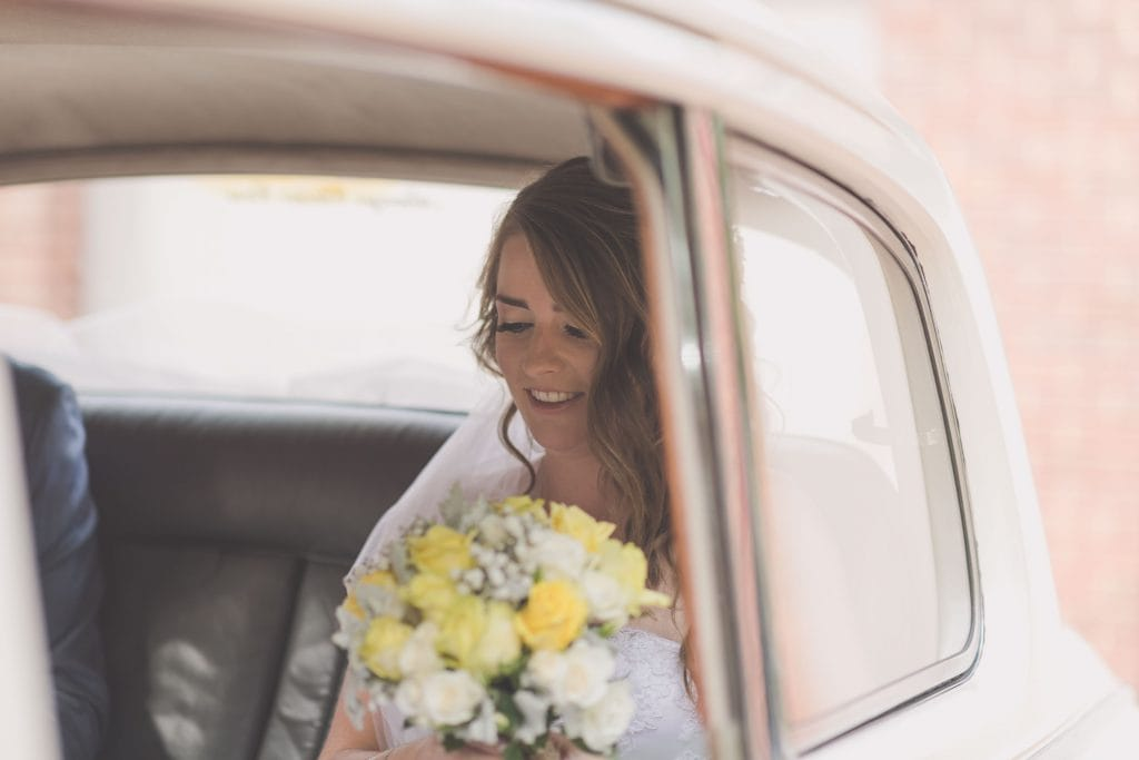 Wedding Photography Melbourne by Pause The Moment - Bride sits in a Rolls Royce at a - Paringa Estate Wedding Photographer
