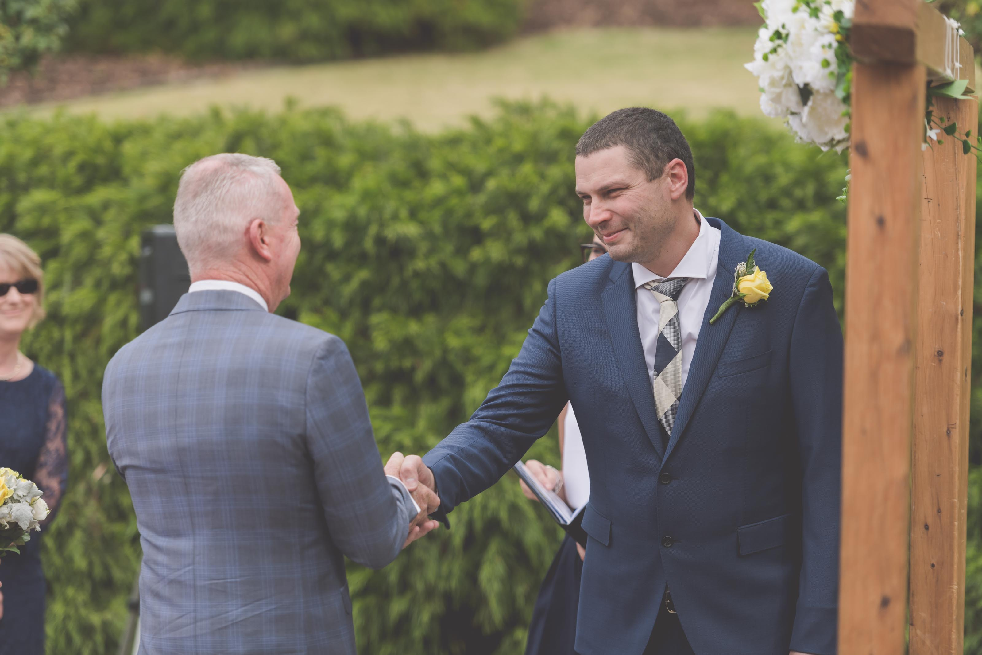 Wedding Photography Melbourne by Pause The Moment - Beautiful wedding photography of a groom and his new father in law - Paringa Estate Wedding Photographer