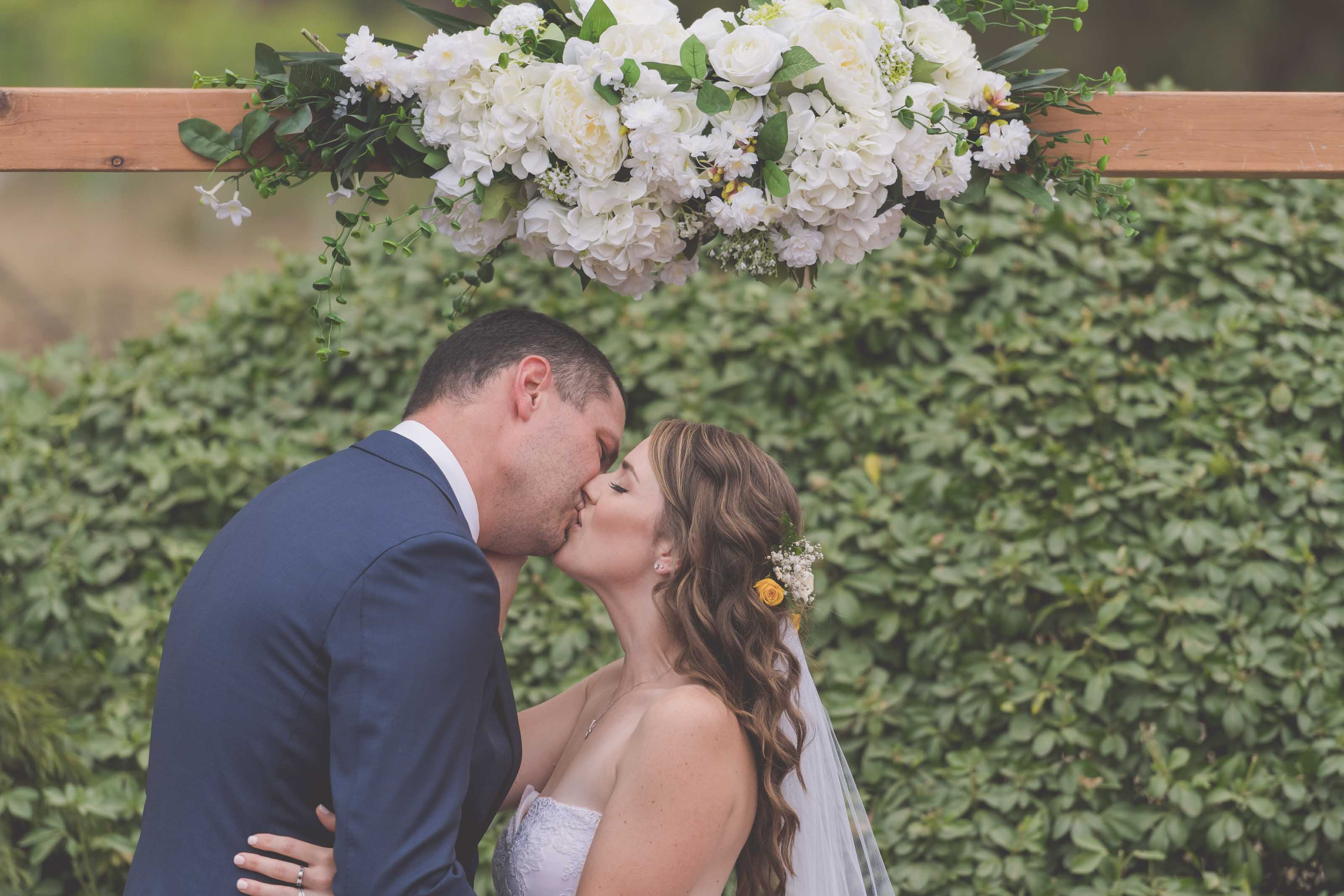 Wedding Photography Melbourne by Pause The Moment - Bride and groom share their first kiss at this Melbourne wedding - Paringa Estate Wedding Photographer