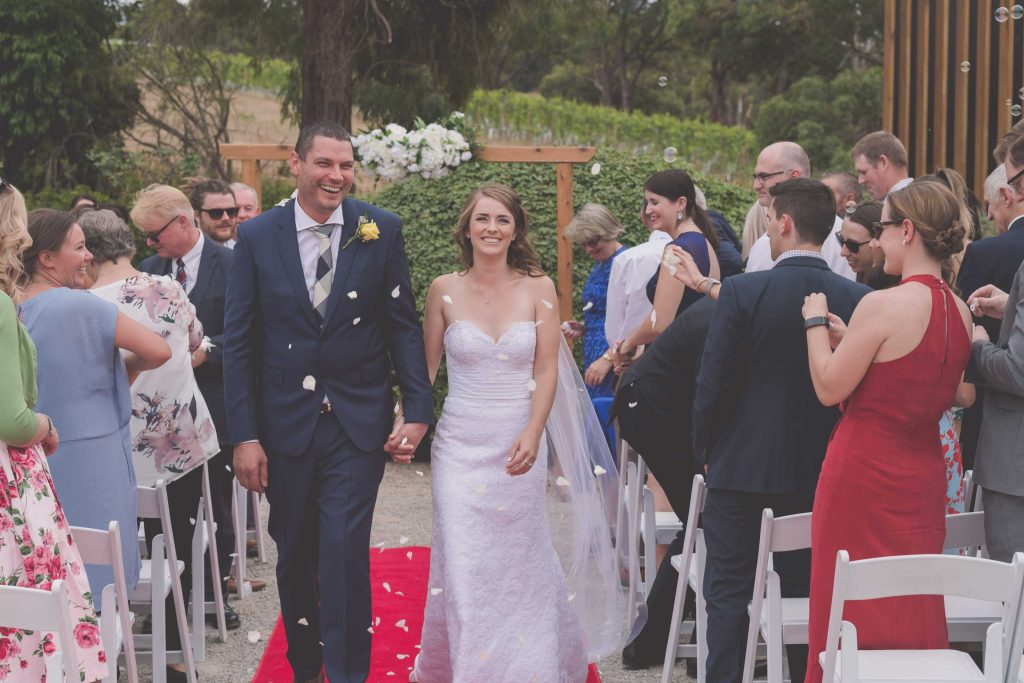 Wedding Photography Melbourne by Pause The Moment - Gorgeous Melbourne wedding photography of a bride and groom walking down the aisle after their wedding - Paringa Estate Wedding Photographer