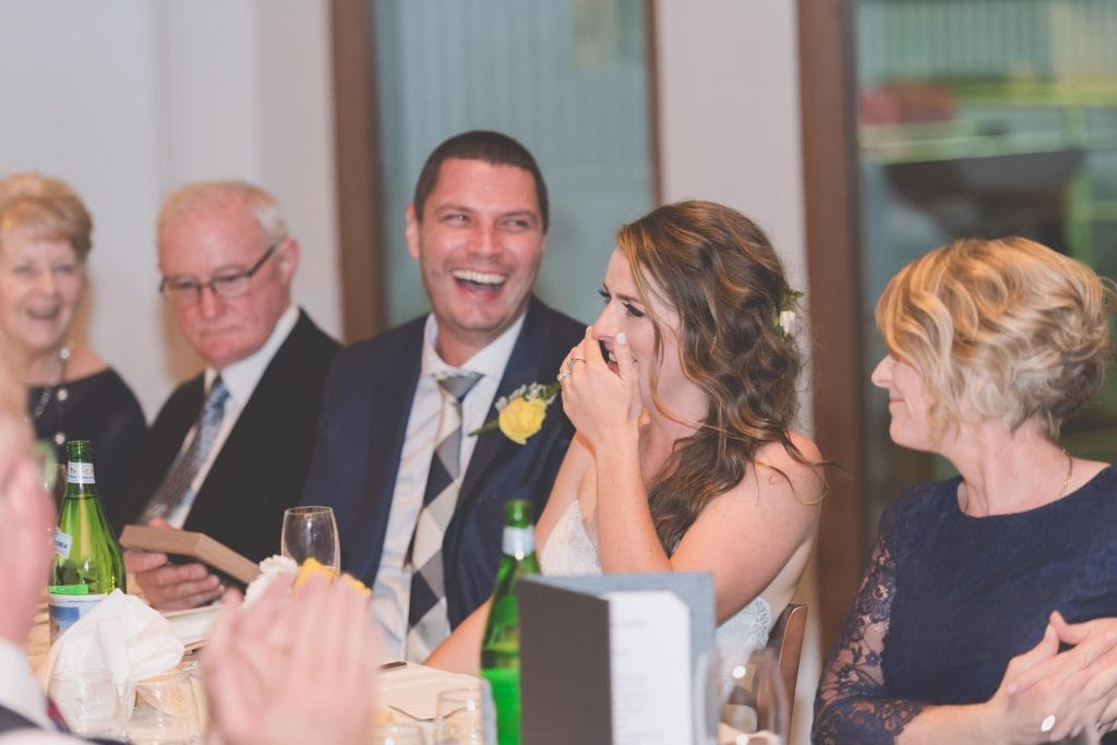 Wedding Photography Melbourne by Pause The Moment - Bride and groom laugh at a wedding speech - Paringa Estate Wedding Photographer