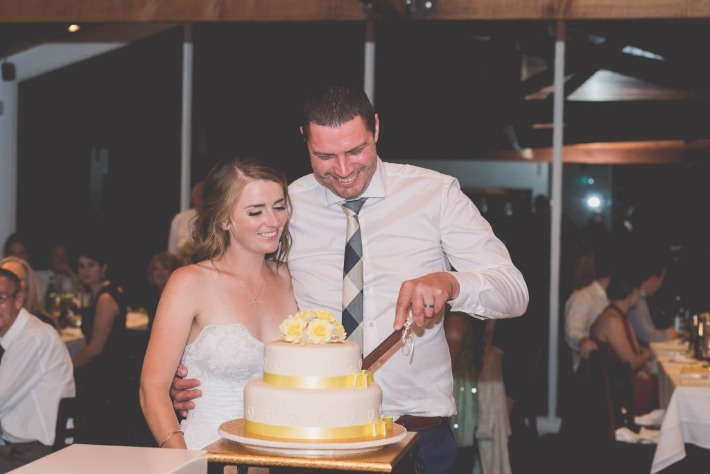 Wedding Photography Melbourne by Pause The Moment - Cutting the cake at a wedding - Paringa Estate Wedding Photographer