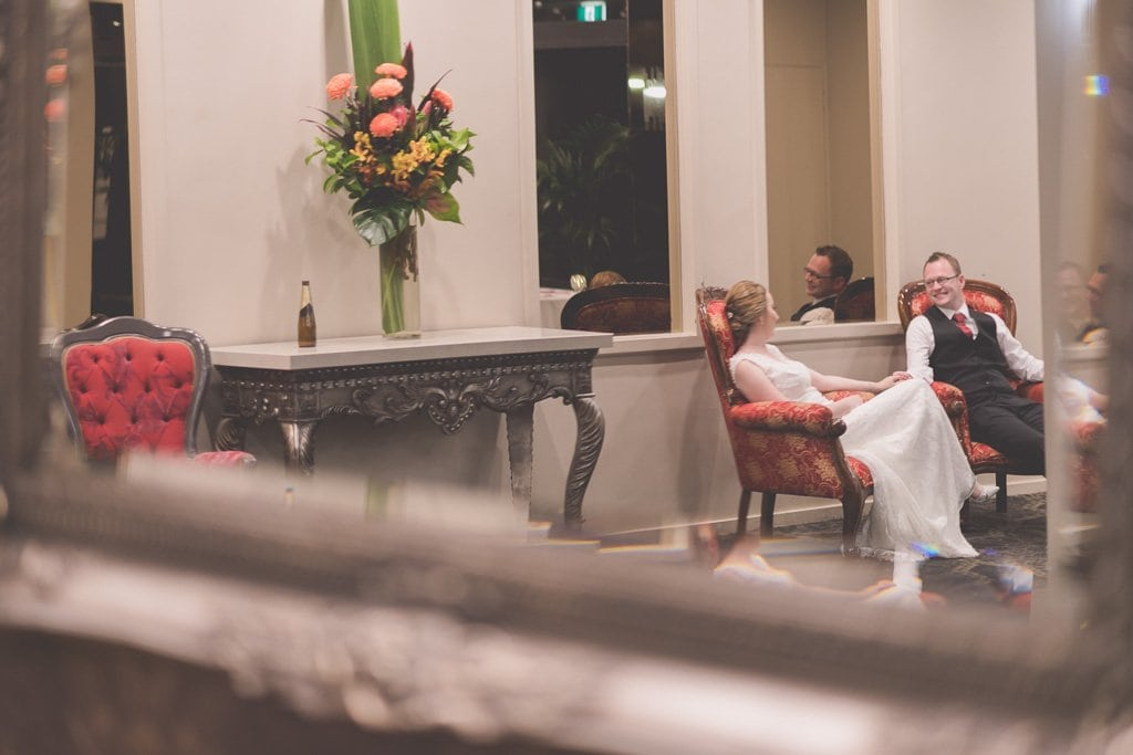 Gorgeous Melbourne wedding photography by Pause The Moment of a bride and groom resting towards the end of their wedding at Lincoln on Toorak