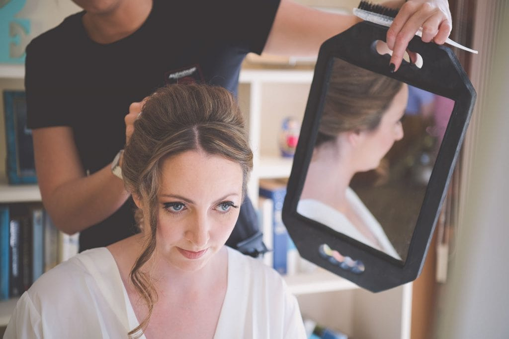 Melbourne wedding photography of the bride having her hair done