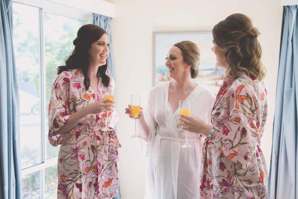 Melbourne wedding photography of the bride and bridesmaids sharing mimosas