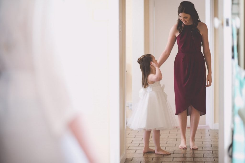 Melbourne wedding photography of the flower girl and a bridesmaid in a corridor