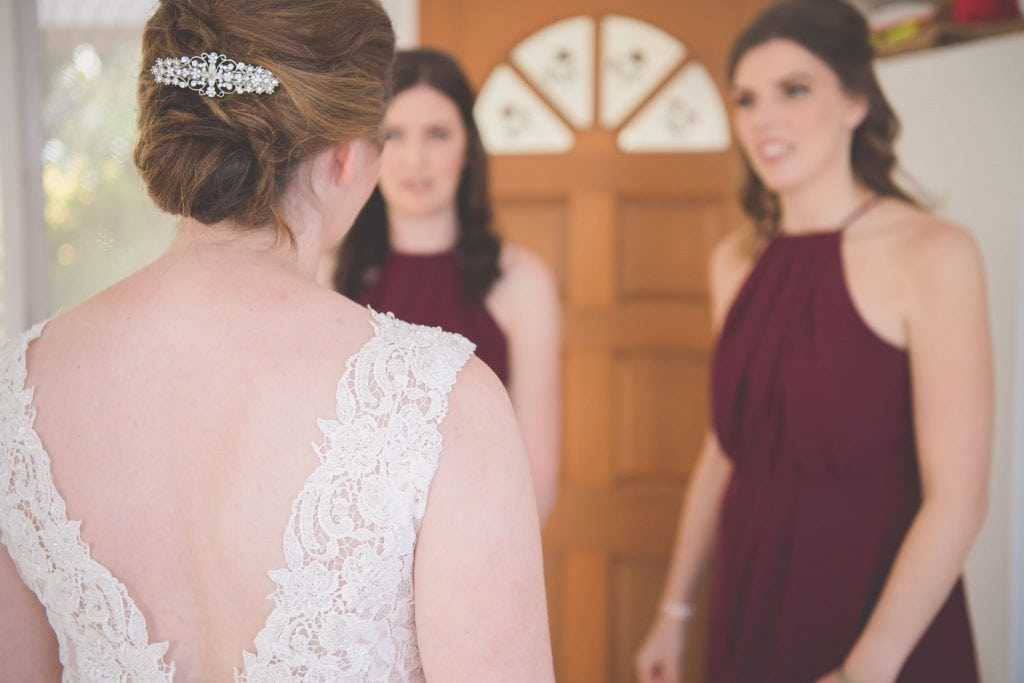 Melbourne wedding photography of the bride's back with lace detail of. her wedding dress