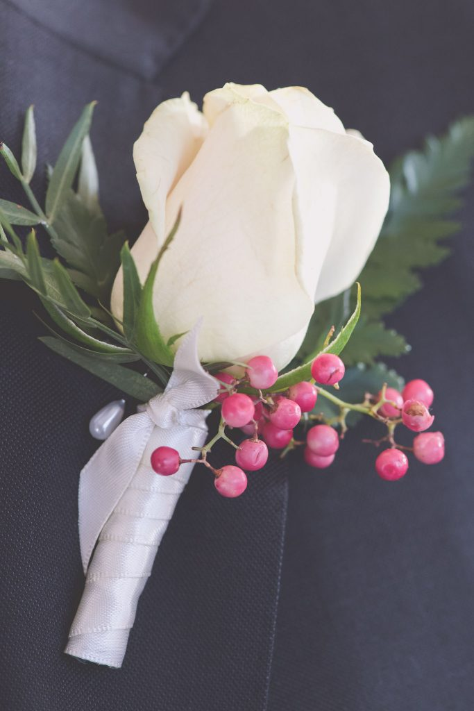 Melbourne wedding photography of a white rose boutonniere