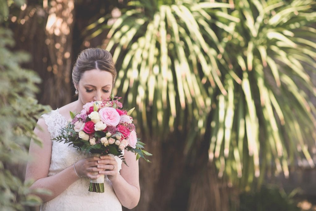 Melbourne wedding photography of the bride smelling her flowers