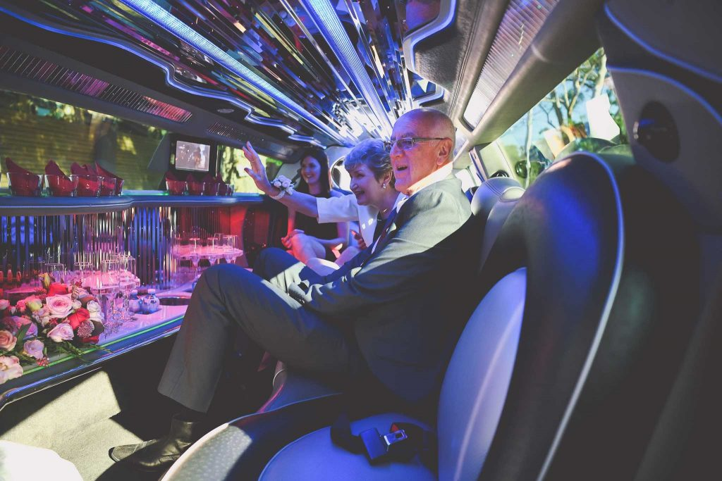 A family in a limousine at a Melbourne wedding.