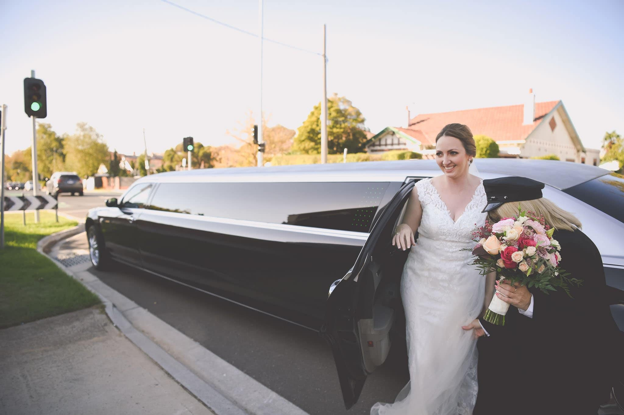Melbourne wedding photography of the bride getting out of her limousine