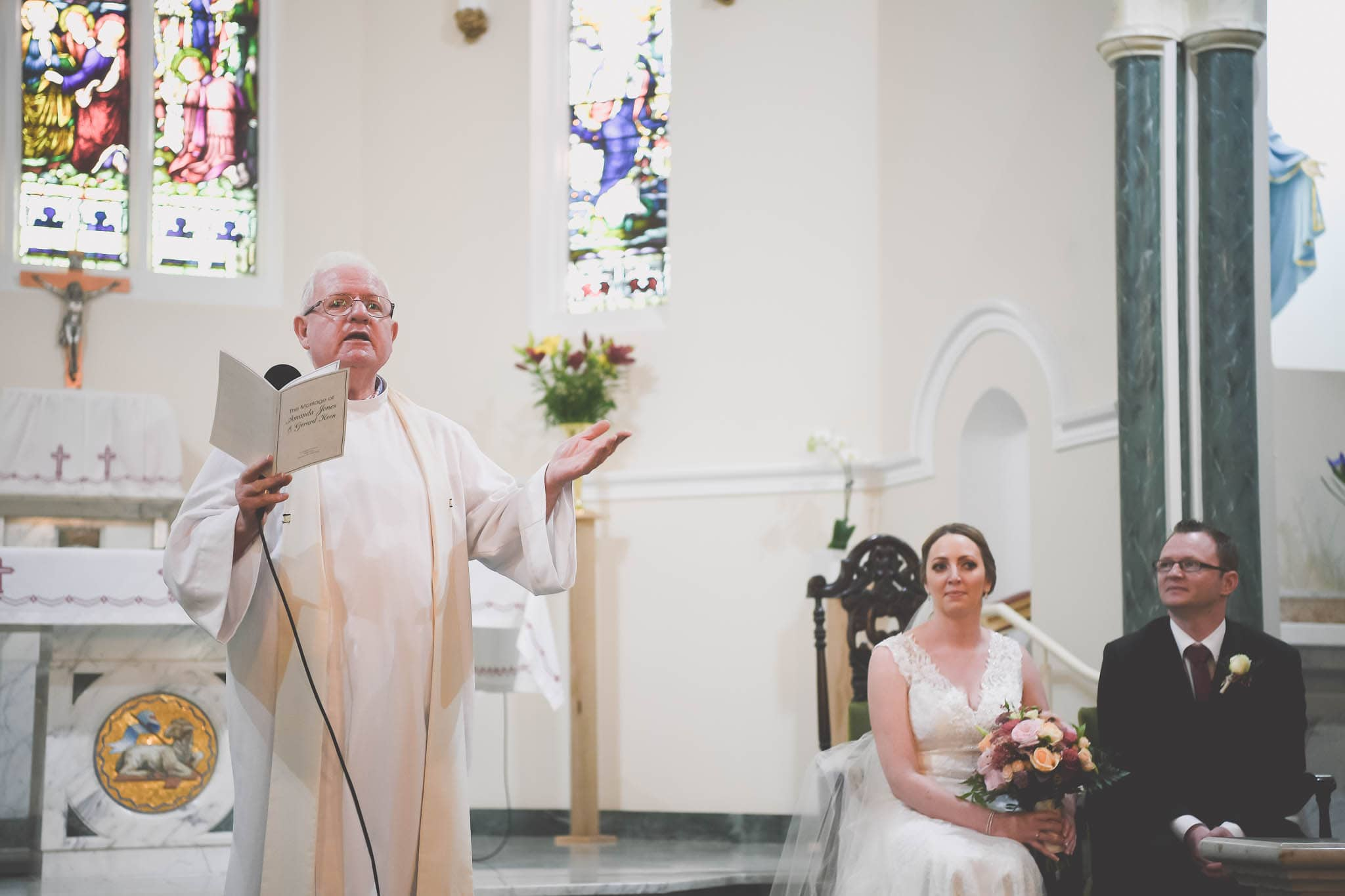 Melbourne wedding photographer Pause The Moment capture an image of a priest delivering a sermon at a wedding.
