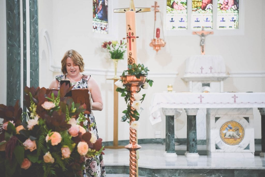 Pause the Moment wedding photography capture a friend giving a speech in a church at a wedding