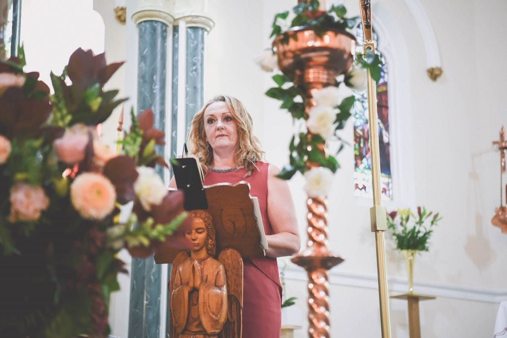 A woman gives a reading at a wedding in Melbourne